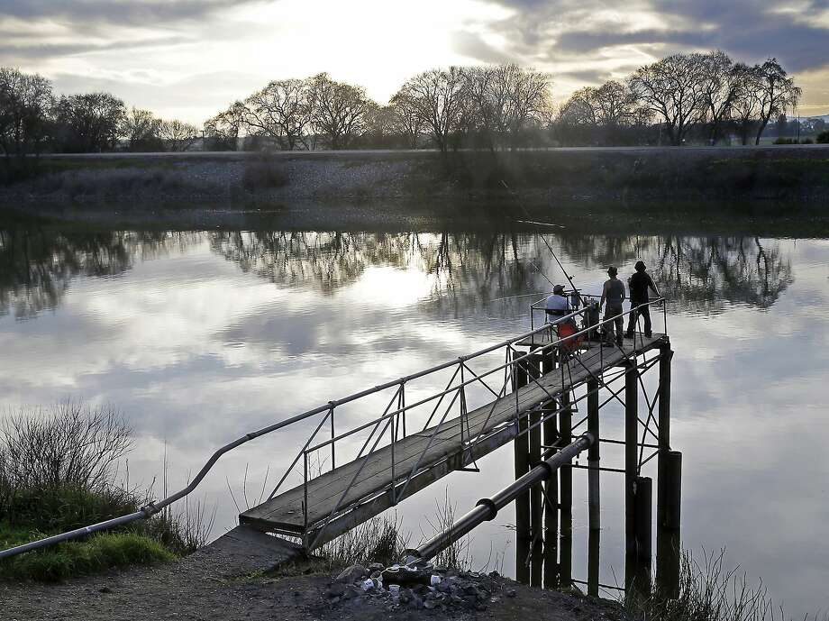 People try to catch fish from the Sacramento River near Courtland. Gov. Jerry Brown's plan would build two tunnels to move water through the delta. Photo: Rich Pedroncelli / Associated Press 2016
