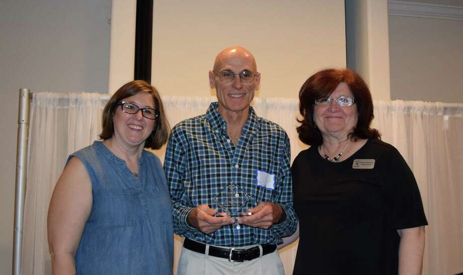 Mandy Stegint, far left, and Marilyn McQueeney present the CASA Rookie of the Year award to Ron Finch, center. Photo: Courtesy Photo