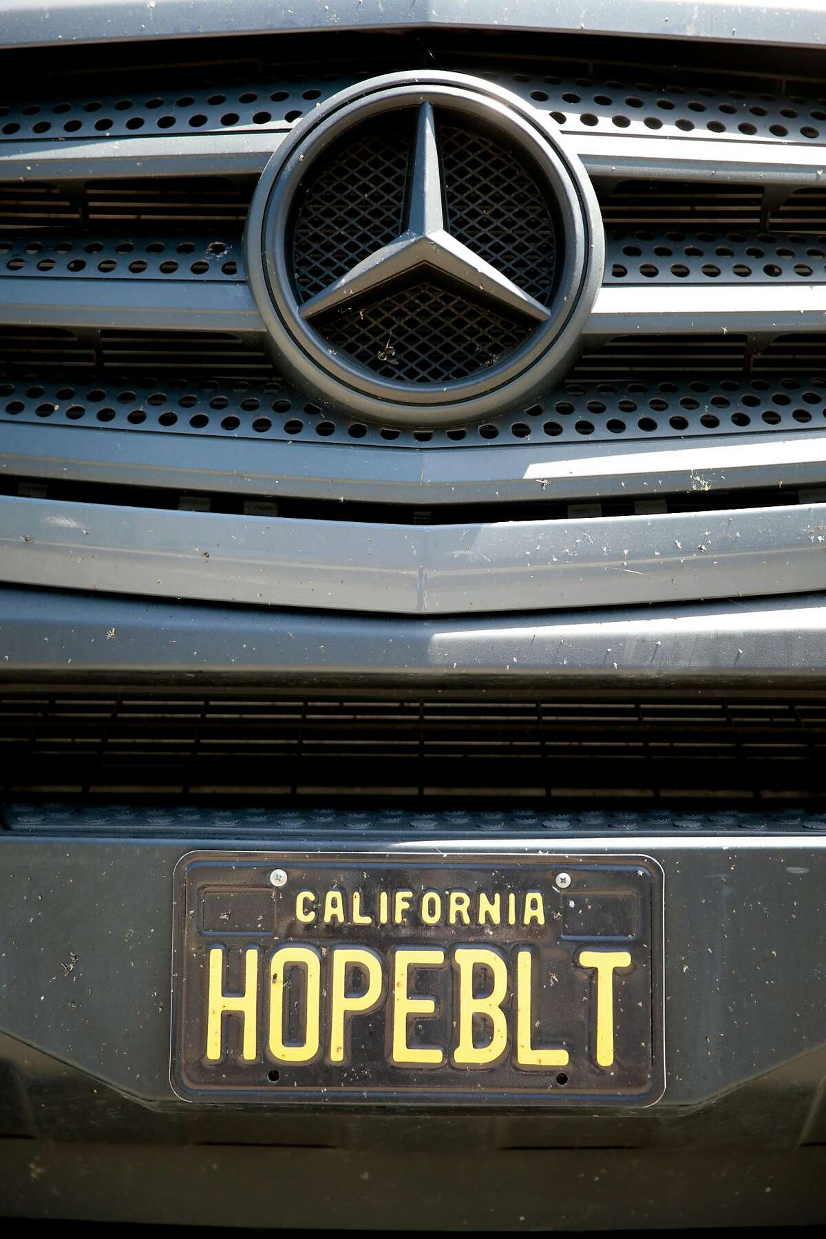 The vanity plate on one of the Hope family Mercedes-Benz Sprinter cargo vans in Petaluma.