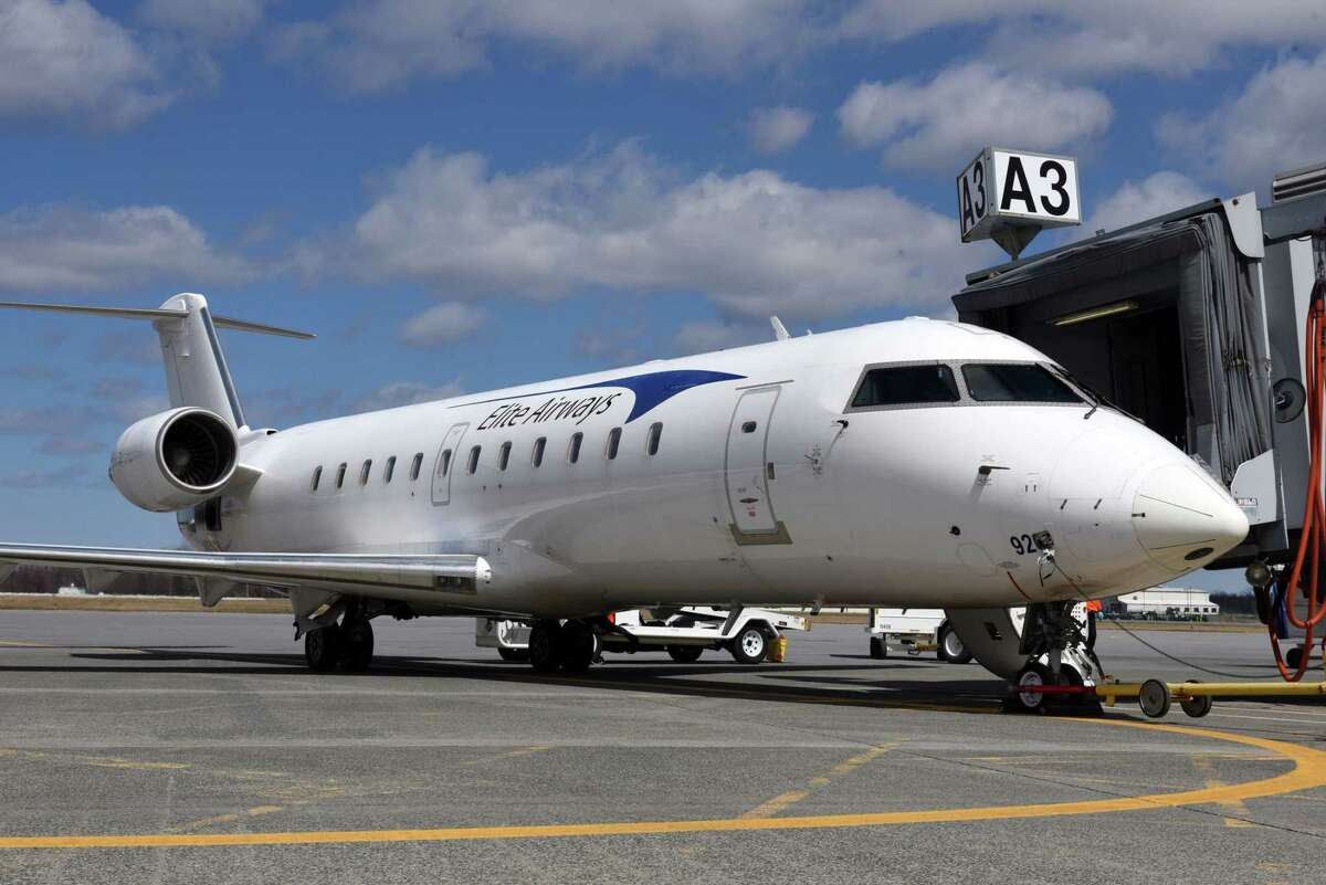 An Elite Airways Bombardier CRJ200 regional jet sits at the gate at Albany International Airport before departing for Myrtle Beach on Thursday, April 5, 2018, in Colonie, N.Y. The airline offers non-stop service on Thursday and Sunday. (Will Waldron/Times Union)