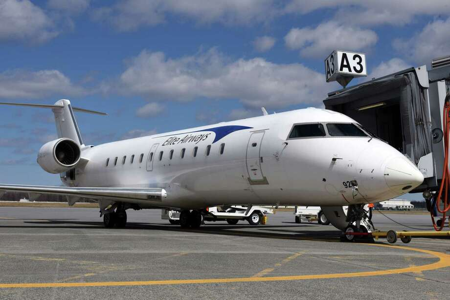 An Elite Airways Bombardier CRJ200 regional jet sits at the gate at Albany International Airport before departing for Myrtle Beach on Thursday, April 5, 2018, in Colonie, N.Y. The airline offers non-stop service on Thursday and Sunday. (Will Waldron/Times Union) Photo: Will Waldron / 40043391A