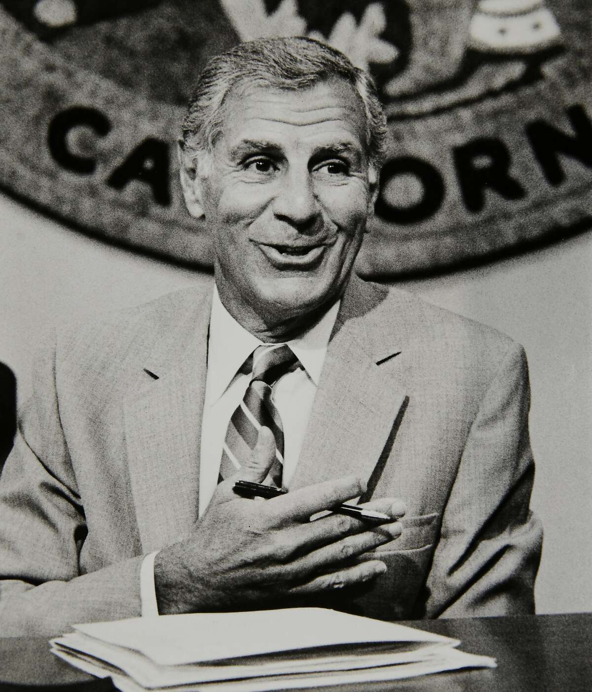 """Gov. George Deukmejian talks with reporters at his office in the Capitol in Sacramento on Sept. 21, 1987.The two-term California governor, whose anti-spending credo earned him the nickname """"The Iron Duke,"""" died Tuesday, May 8, 2018, of natural causes, a former chief of staff said. He was 89."""