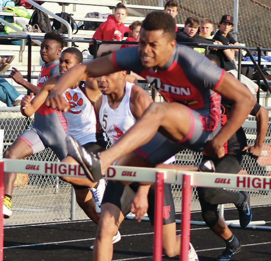 Alton's Johnathan Bumpers clears a hurdle on his way to victory in the 110-meter high hurdles at the Madison County Meet last month in Highland. Bumpers' hopes of winning a Southwestern Conference hurdles championship was put on hold until Friday after Tuesday's SWC Meet at East St. Louis was suspended after a fight broke out in the stands. Only the varsity shot put competition was completed Wednesday, with Edwardsville's Amari Brooks first with a throw of 53 feet, 10.5 inches and Alton's Jaquez Roberson second at 49-7. The meet will resume Friday at site — likely Edwardsville, O'Fallon or Collinsville — expected to be finalized Wednesday morning.