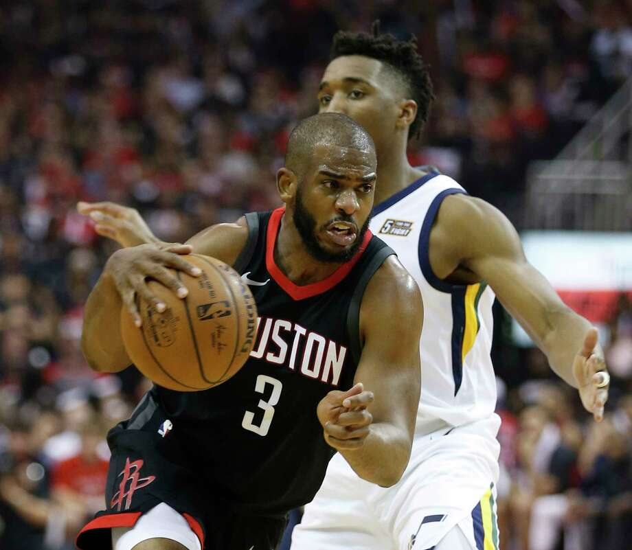 Houston Rockets guard Chris Paul (3) drives around Utah Jazz guard Donovan Mitchell (45) during the first half in Game 5 of an NBA basketball second-round playoff series at Toyota Center, Tuesday, May 8, 2018, in Houston. Photo: Brett Coomer,  Staff / Houston Chronicle / © 2018 Houston Chronicle