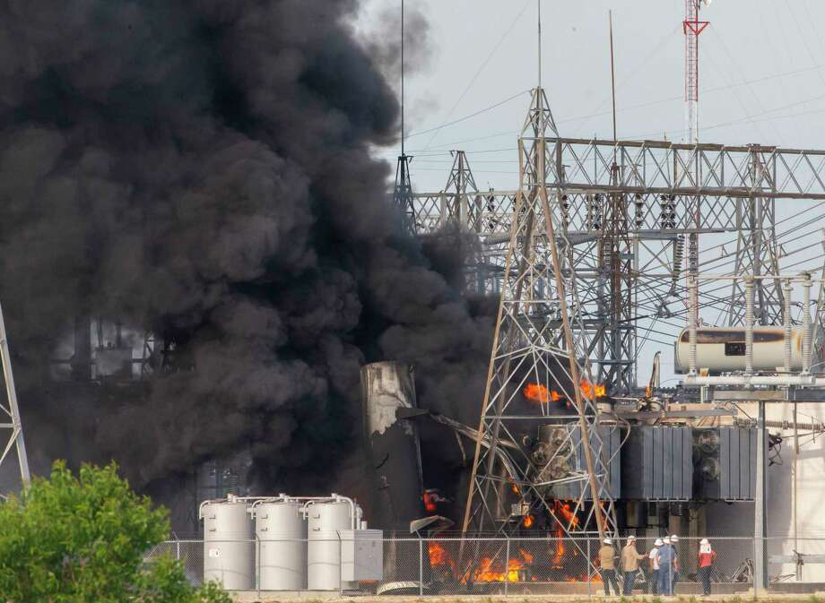 Workers watch as flames and smoke rise from a transformer fire at a CenterPoint Energy substation on state Highway 146 in Texas City on Tuesday, May 8, 2018. Photo: STUART VILLANUEVA/The Daily News / © 2018 STUART VILLANUEVA/The Daily News