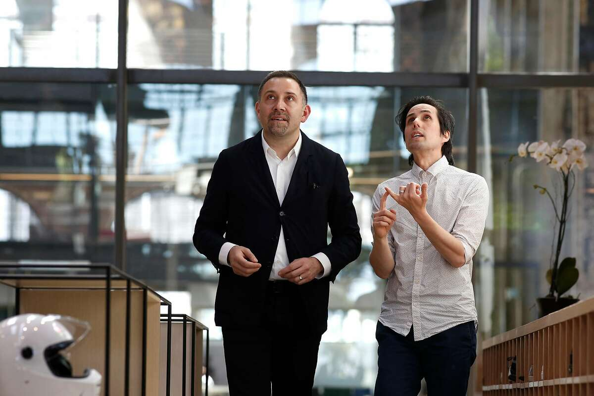 Marcus Hopper, (left) the project manager, and Ian Young, the architect of the space at the new workspace of the startup Gusto, in San Francisco, Ca. on Mon. May 7, 2018. Gusto, a 250-person startup just transformed a 50,000 square foot steel shop into a giant living room for employees and guests at SF's Pier 70.