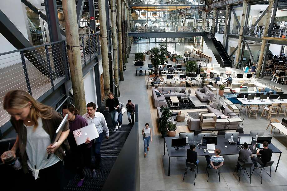 Gusto's 275 workers in San Francisco basically all occupy one gigantic room on Pier 70 in the Dogpatch, with the choice of having an assigned workbench or floating among the many couches, counters and desks. Photo: Photos By Michael Macor / The Chronicle