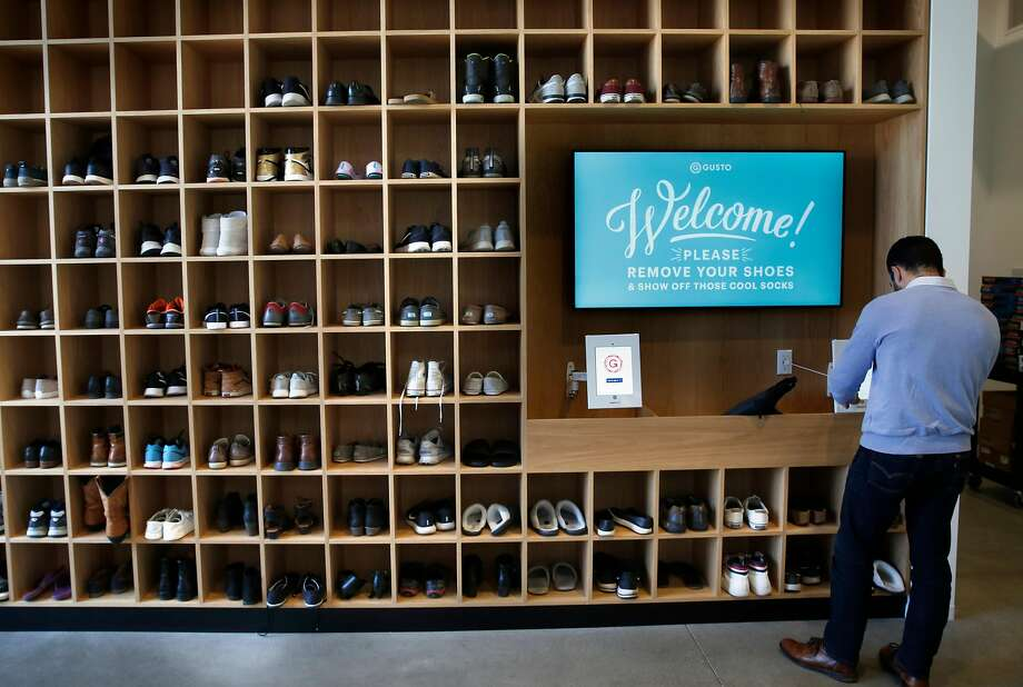 Visitors and employees are asked to remove their shoes at the new office; paper slippers are given to guests. Photo: Michael Macor / The Chronicle