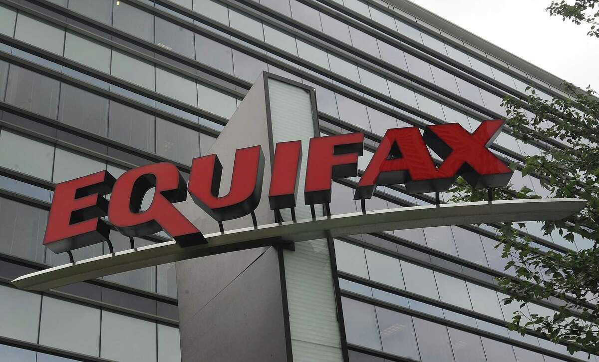 This Saturday, July 21, 201 file, photo shows signage at the corporate headquarters of Equifax Inc. in Atlanta. Equifax has disclosed to lawmakers that its data breach exposed more of consumers' personal information than the company first made public last year. The credit reporting company submitted paperwork to the Senate Banking Committee showing criminals accessed information such as tax identification numbers, email addresses, phone numbers and more, Friday, Feb. 9, 2018. (AP Photo/Mike Stewart, File)