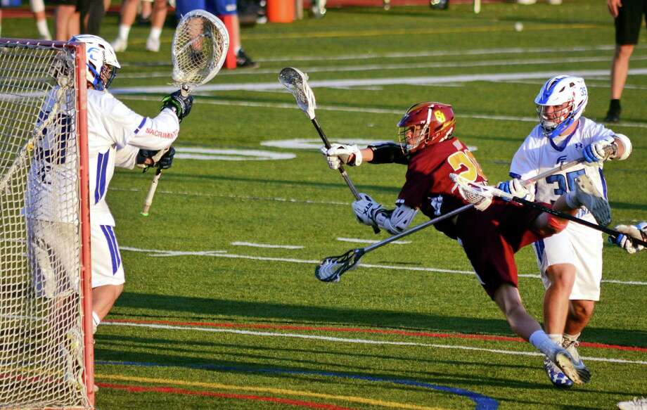 Fairfield Ludlowe goalie Carter Leibrock (23) stops a shot by St. Joseph's Declan McGinley (29) during boys lacrosse action in Fairfield, Conn., on Tuesday May 8, 2018. Photo: Christian Abraham / Hearst Connecticut Media / Connecticut Post