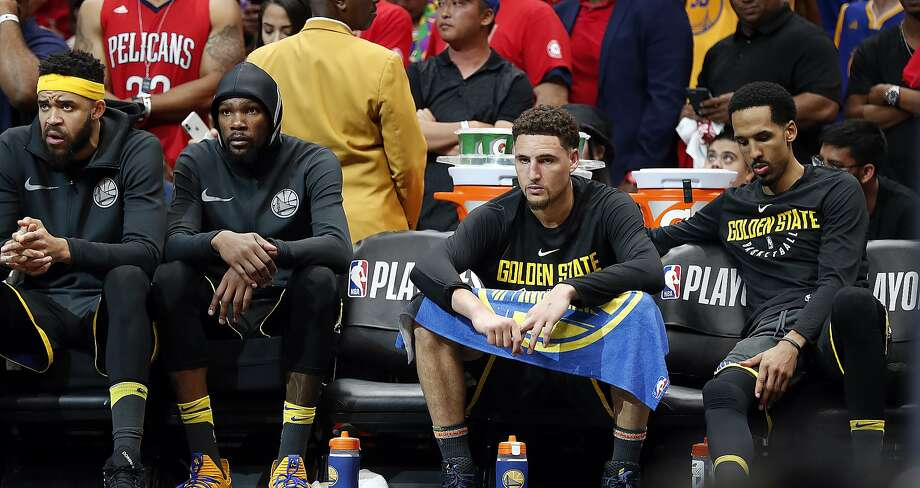 From left to right, Golden State Warriors center JaVale McGee, forward Kevin Durant, guard Klay Thompson and guard Shaun Livingston watch from the bench during the second half of Game 3 of a second-round NBA basketball playoff series against the New Orleans Pelicans in New Orleans, Friday, May 4, 2018. (AP Photo/Gerald Herbert) Photo: Gerald Herbert / Associated Press