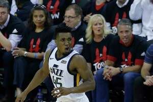 Utah Jazz guard Donovan Mitchell (45) celebrates a three-pointer during the second half in Game 5 of an NBA basketball second-round playoff series at Toyota Center, Tuesday, May 8, 2018, in Houston.