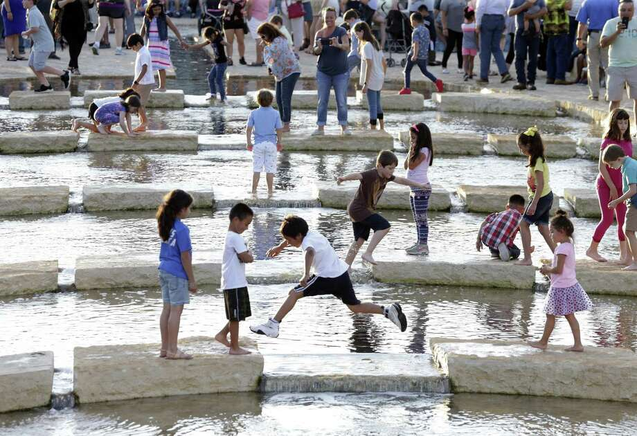 Kids play in the water at San Pedro Creek Culture Park on May 5, 2018. Photo: Tom Reel, Staff / San Antonio Express-News / 2017 SAN ANTONIO EXPRESS-NEWS