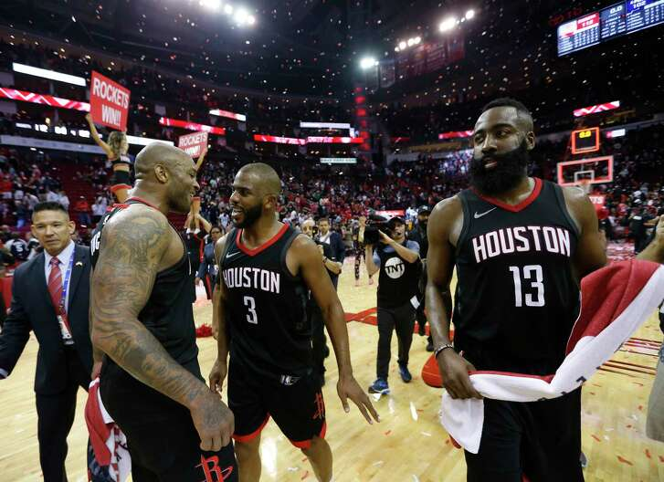 Houston Rockets guards Chris Paul (3) and forward PJ Tucker (4) along with James Harden (13) celebrate the Rockets win over Utah Jazz during the second half in Game 5 of an NBA basketball second-round playoff series at Toyota Center, Tuesday, May 8, 2018, in Houston.
