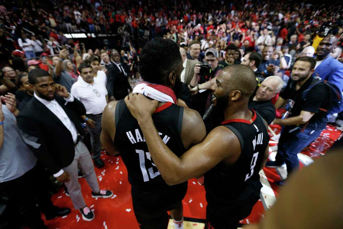 Houston Rockets guards Chris Paul (3) and James Harden (13) celebrate the Rockets win over Utah Jazz during the second half in Game 5 of an NBA basketball second-round playoff series at Toyota Center, Tuesday, May 8, 2018, in Houston.