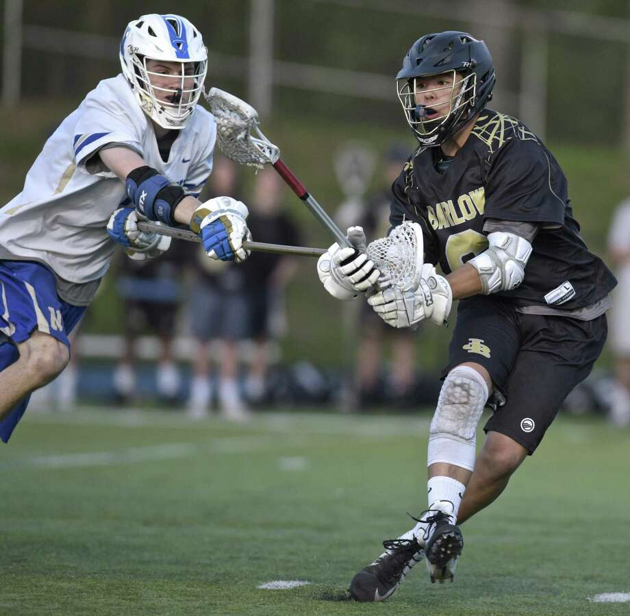 Barlow's Colby Powers (6) tries to keep control of the ball as Newtown's Cayden Dunn (7) reaches in during the boys lacrosse game between Joel Barlow and Newtown high schools on Tuesday night May 8, 2018 at Newtown High School, in Newtown, Conn. Photo: H John Voorhees III / Hearst Connecticut Media / The News-Times