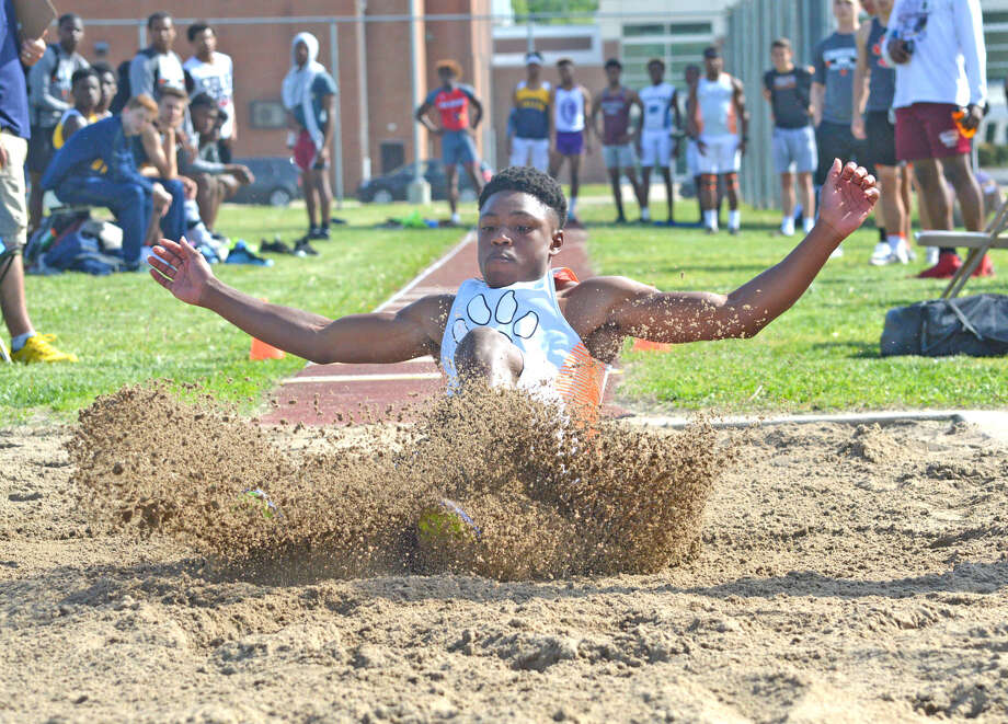 Edwardsville sophomore Kenyon Johnson competes in the long jump during Tuesday's Southwestern Conference Meet at East St. Louis. A fight amongst spectators in the grandstand forced the suspension of the meet.