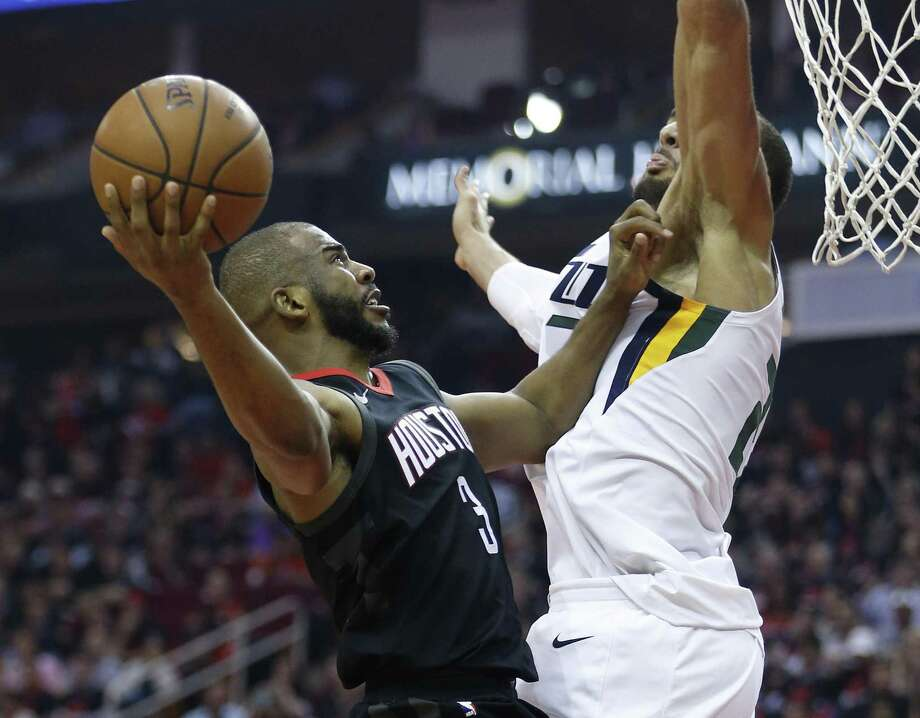 No task was too tall for Rockets guard Chris Paul, who goes up sgainst Jazz center Rudy Gobert ) during the first half of Game 5 on Tuesday night. Photo: Michael Ciaglo, Staff / Houston Chronicle / © 2018 Houston Chronicle