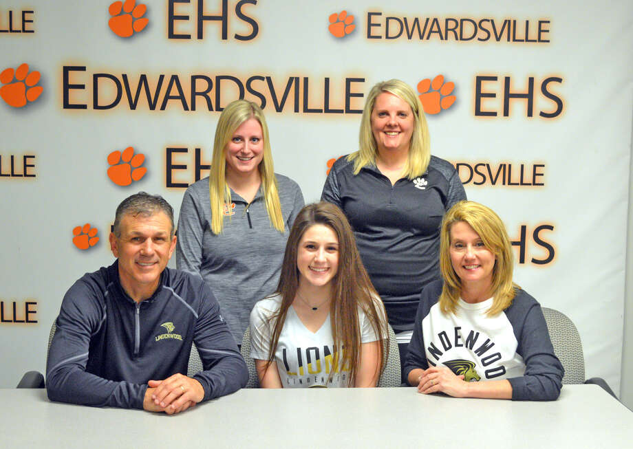 Edwardsville senior Rachel Mullican will be a cheerleader at Lindenwood University. In the front row, from left to right, are mother Sarah Mullican, Rachel Mullican and father Greg Mullican. In the back row, from left to right, are EHS head coach Cayla Bowen and EHS assistant coach Ashley Walsh.