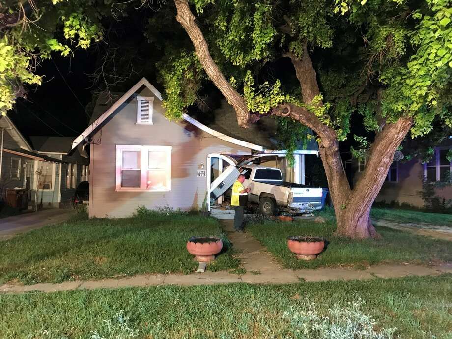 A driver allegedly lost control of his truck and ran into two homes Tuesday evening in the 300 block of Arlington Court, Tuesday, May 8, 2018. Photo: Jacob Beltran