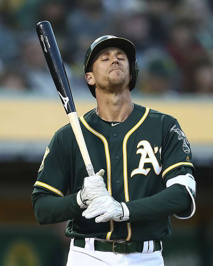 Oakland Athletics' Stephen Piscotty closes his eyes as he acknowledges a standing ovation from fans during the third inning of a baseball game against the Houston Astros Tuesday, May 8, 2018, in Oakland, Calif. Piscotty made his first appearance in a game since the death of his mother, Gretchen Piscotty, on Sunday, less than a year after being diagnosed with amyotrophic lateral sclerosis (ALS), a neuromuscular disorder also known as Lou Gehrig's disease. (AP Photo/Ben Margot) Photo: Ben Margot / Associated Press