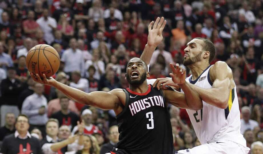 Houston Rockets guard Chris Paul (3) drives to the basket against Utah Jazz center Rudy Gobert (27) during the second half in Game 5 of an NBA basketball second-round playoff series at Toyota Center, Tuesday, May 8, 2018, in Houston. ( Brett Coomer / Houston Chronicle ) Photo: Brett Coomer, Staff / Houston Chronicle / © 2018 Houston Chronicle
