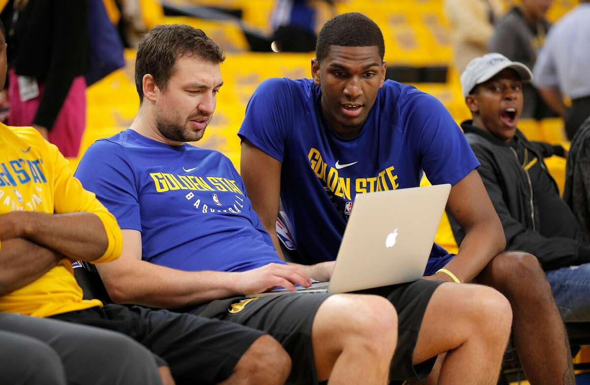 Warriors coach Chris DeMarco, (left) watches game video with Kevon Looneys as the Golden State Warriors prepare to take on the New Orleans Pelicans in game 5 of the NBA Western Conference semifinals at Oracle Arena in Oakland, Ca. on Tues. May 8, 2018.