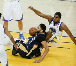 New Orleans Pelicans' Anthony Davis fouls Golden State Warriors' Kevon Looney in the second quarter during game 5 of the Western Conference Semifinals between the Golden State Warriors and the New Orleans Pelicans at Oracle Arena on Tuesday, May 8, 2018 in Oakland, Calif.