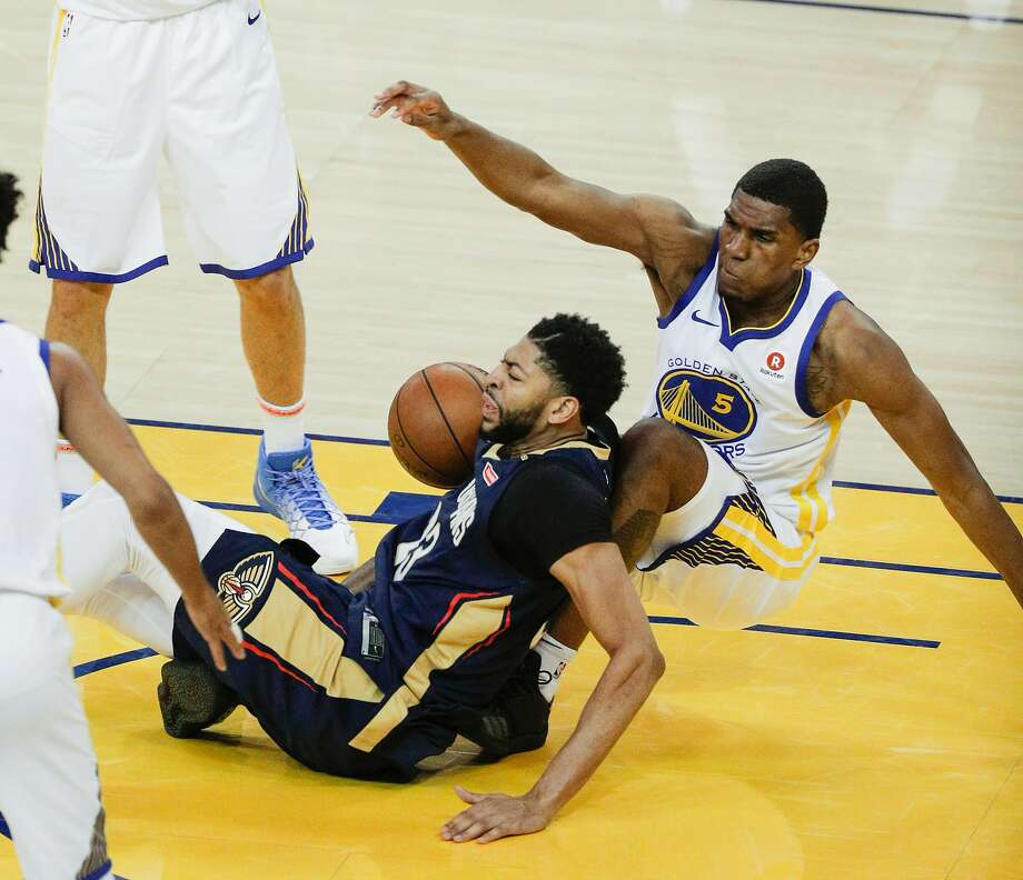 69dce1670a9 New Orleans Pelicans  Anthony Davis fouls Golden State Warriors  Kevon  Looney in the second