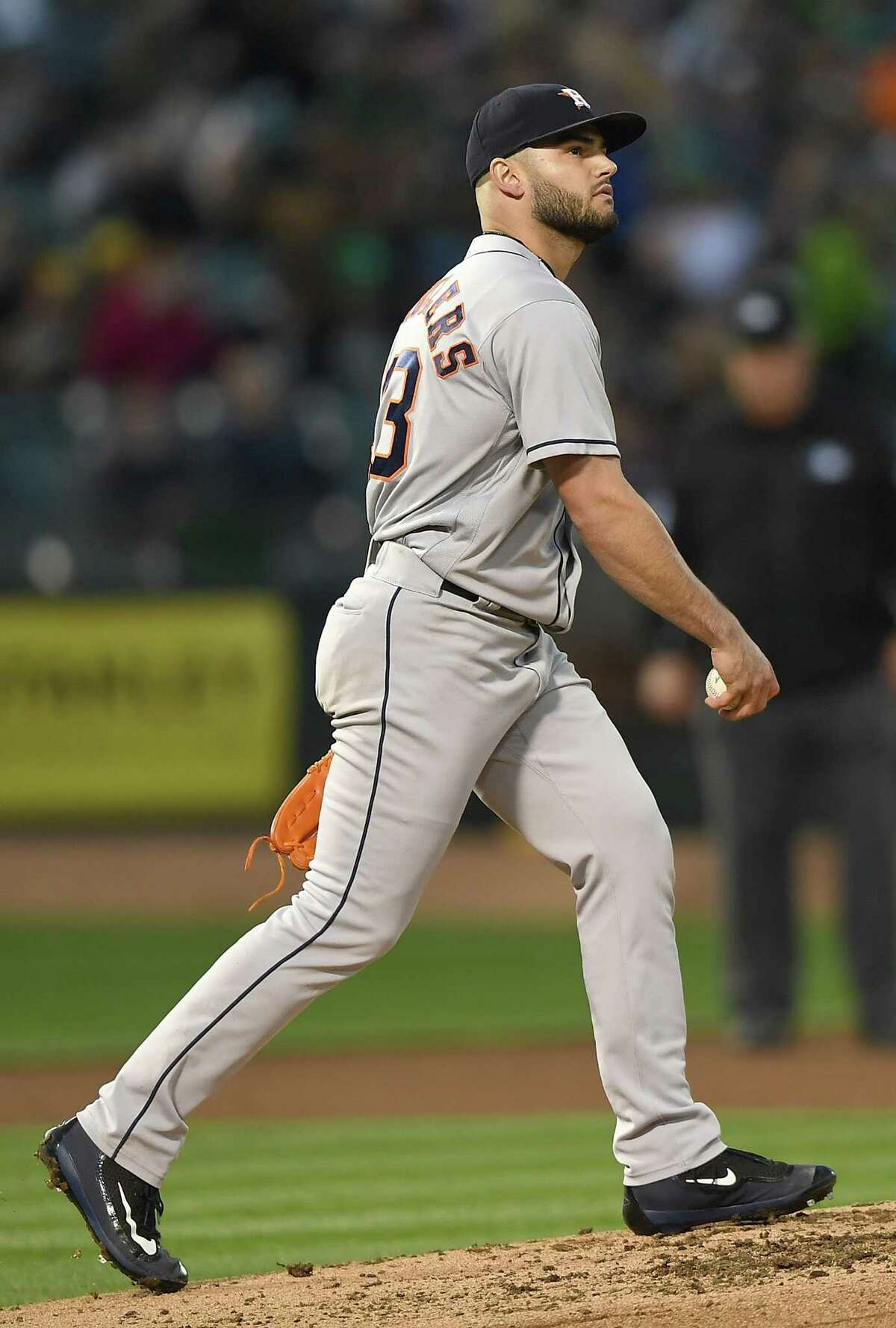 OAKLAND, CA - MAY 08: Lance McCullers Jr. #43 of the Houston Astros reacts walking back up on the mound with a new ball after walking Jed Lowrie #8 of the Oakland Athletics to load the bases in the bottom of the third inning at the Oakland Alameda Coliseum on May 8, 2018 in Oakland, California.