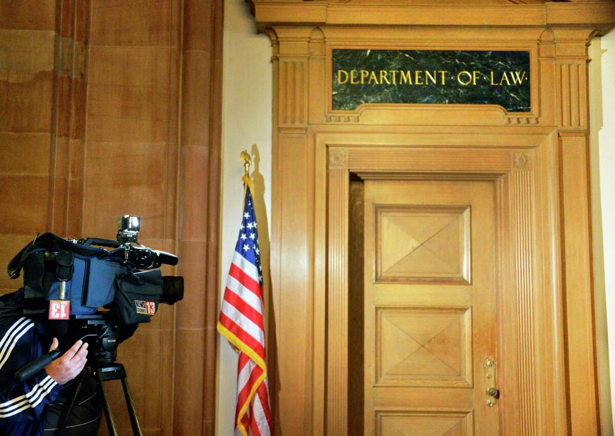 A television cameraman photographs the locked entrance to the NYS Department of Justice in the Capitol Tuesday May 8, 2018 in Albany, NY. (John Carl D'Annibale/Times Union)