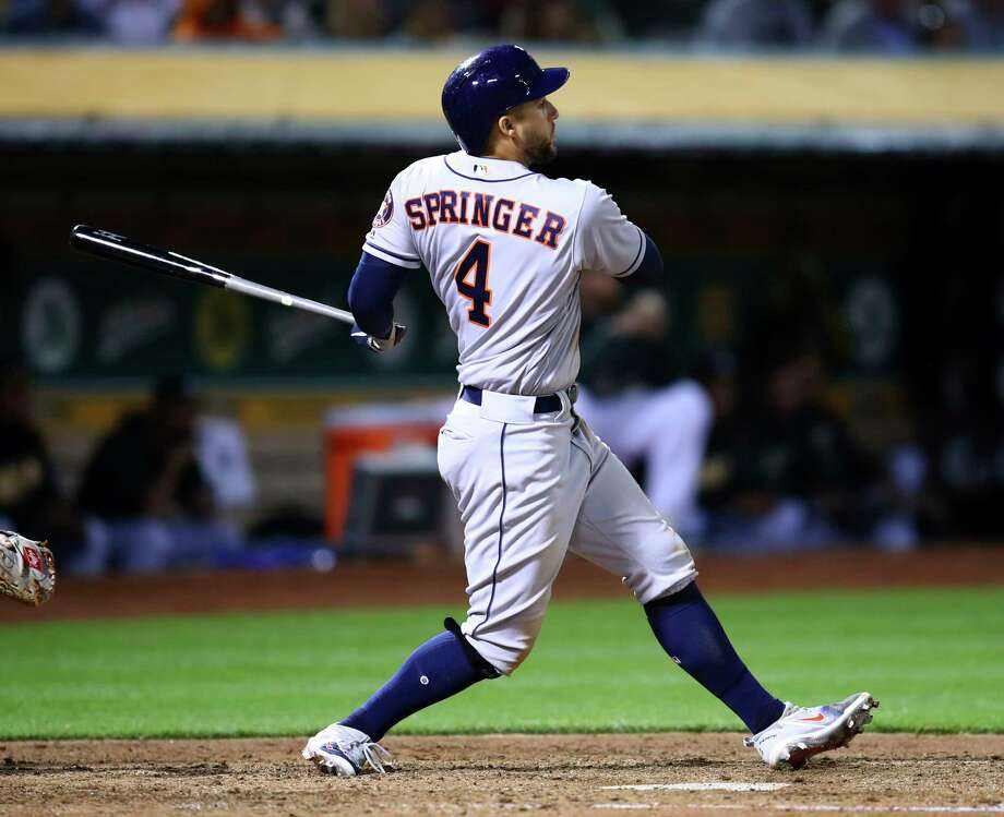 Houston Astros' George Springer watches his two run double hit off Oakland Athletics' Sean Manaea in the fifth of a baseball game Tuesday, May 8, 2018, in Oakland, Calif. (AP Photo/Ben Margot) Photo: Ben Margot, Associated Press / Copyright 2018 The Associated Press. All rights reserved.
