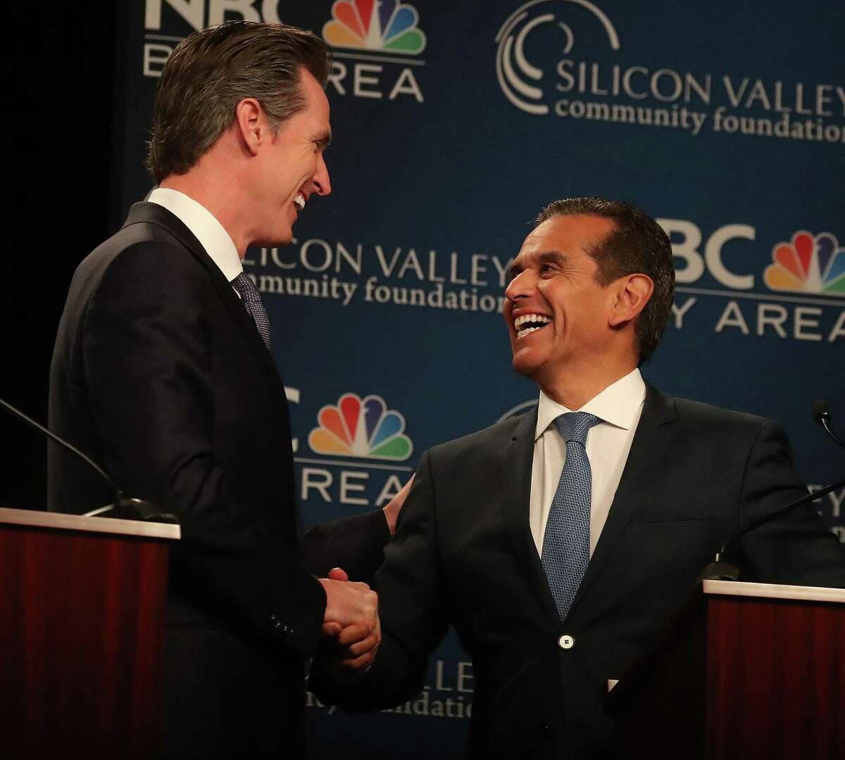 """Democratic candidates Gavin Newsom, left, and Antonio Villaraigosa, right, shake hands after the """"Decision 2018: The Race for Governor"""" debate at the California Theatre on Tuesday, May 8, 2018, in San Jose, Calif. (Aric Crabb/Bay Area News Group)"""
