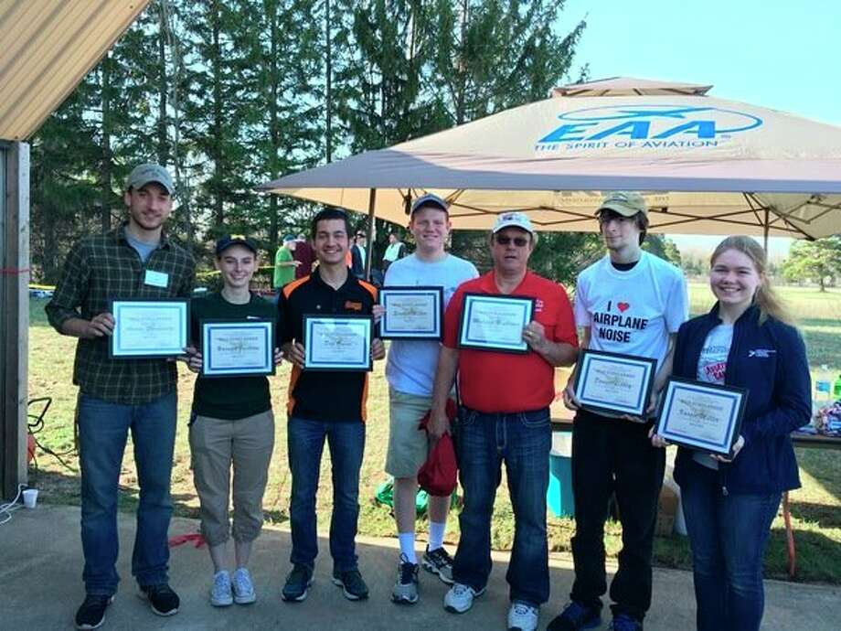 The Experimental Aircraft Association, Chapter 1093, based at the Midland Jack Barstow Airport, awarded seven scholarships at its weekend pancake breakfast. These scholarships will be used to further the recipients' aviation goals, including as schooling, flying lessons and/or obtaining a mechanic's license. From left, Aaron Smokovitz, who received a Jim Dobben Memorial Scholarship; Hannah Jackson, Don Owens and Scottie Miller, who received an EAA Chapter 1093 Scholarship; Malcomb Brukaker, who received a Jim Dobben Memorial Scholarship; Daniel Libbery, who received the David Ward Memorial Scholarship; and Kassie Miller, who received one of the Chapter 1093 Scholarships. (Photo provided)