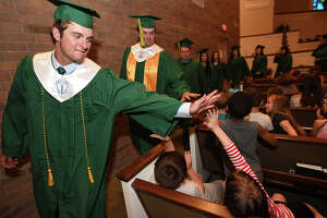 Little Cypress-Mauriceville High School seniors walk through North Orange Baptist Church Monday, May 07 during Senior Walk Day. The event allows the soon-to-be graduates to walk through their alma mater elementary school and encourages the younger children to stay in school.   Photo taken Monday, May 07, 2018 Guiseppe Barranco/The Enterprise