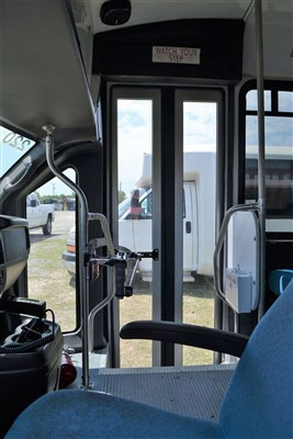 Former airport shuttle buses recently seized from a San Antonio company by Bexar County go on the auction block Wednesday, May 9, 2018. The opening price for each of the vehicles has been set at $1,000.