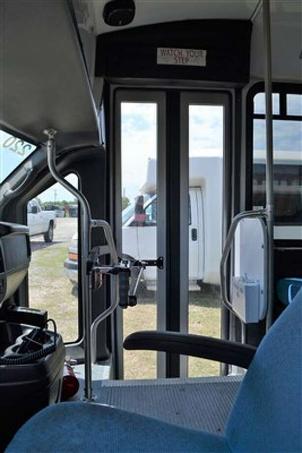 Former airport shuttle buses recently seized from a San Antonio company by Bexar County go on the auction block Wednesday, May 9, 2018. The opening price for each of the vehicles has been set at $1,000. Photo: Courtesy Of Mel Davis Auctions
