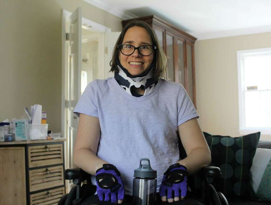 Westport resident Victoria Gouletas in her home on May 3, seven weeks after being paralyzed by a fallen tree outside her home during the March 7 nor'easter. Photo: Sophie Vaughan / Hearst Connecticut Media / Westport News