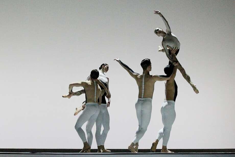 "Maria Kochetkovais lifted aloft in David Dawson's ""Anima Animus,"" part of Program B of the S.F. Ballet's Unbound festival. Photo: Lea Suzuki / The Chronicle"