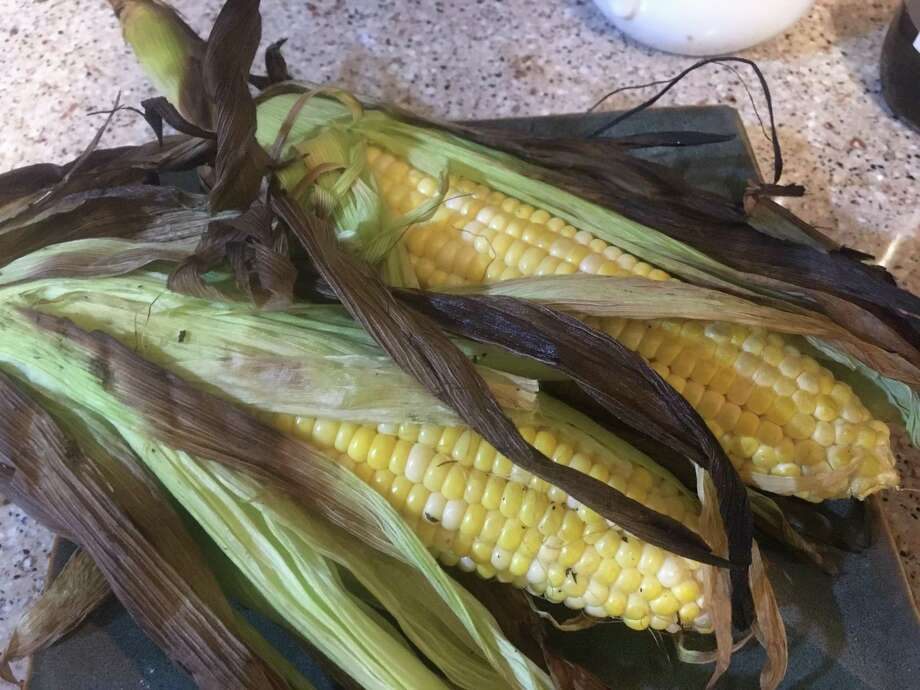 Sweet corn was making its first appearance of the season on May 5 at the New Braunfels Farmers Market, and other area farmers said that theirs will be ready in the next few weeks. It's one of the vegetables that begs to be grilled. Photo: Chuck Blount /San Antonio Express-News