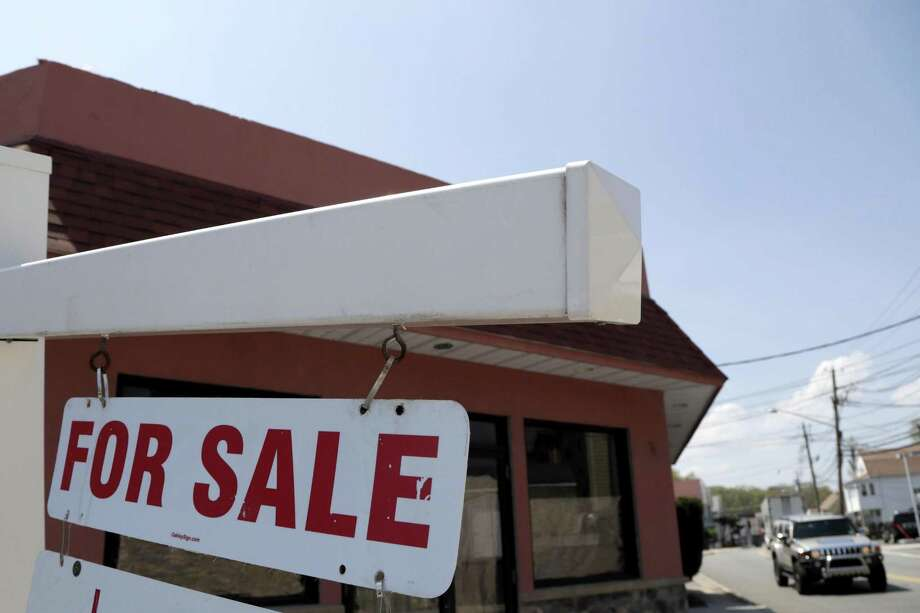 A for sale sign hangs from a post outside of a vacant business building, Thursday, May 3, 2018. Photo: Julio Cortez /Associated Press / Copyright 2018 The Associated Press. All rights reserved.