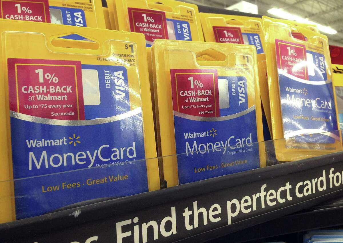 In this March 9, 2017 photo, money cards are displayed at a store in Methuen, Mass. (AP Photo/Elise Amendola)