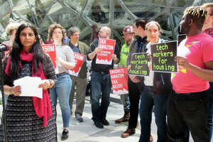Seattle City Councilmember Kshama Sawant (left) and supporters call for a tax on big business during an event at Amazon headquarters last week. (GeekWire Photo / Monica Nickelsburg)