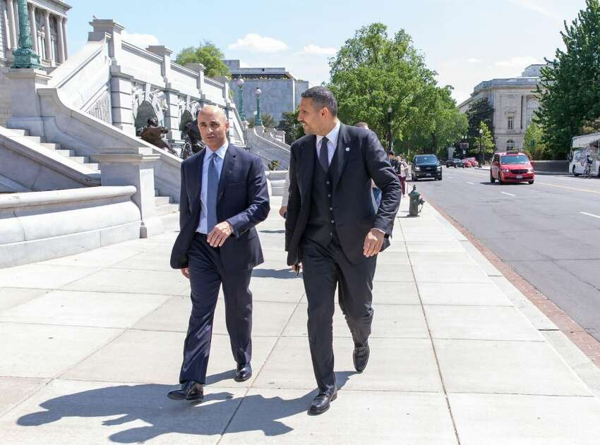 Yousef Al Otaiba, the United Arab Emirates ambassador to the U.S., walks in front of the Library of Congress in Washington, D.C. with Mubadala CEO Khaldoon Al Mubarak following their Monday visit to GlobalFoundries' Fab 8 computer chip factory in Malta.