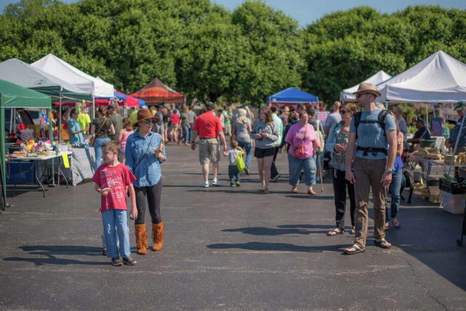Patrons take in all there is to see and do at one last year's Alton Farmers' & Artisans' Market days. Photo:       For The Telegraph