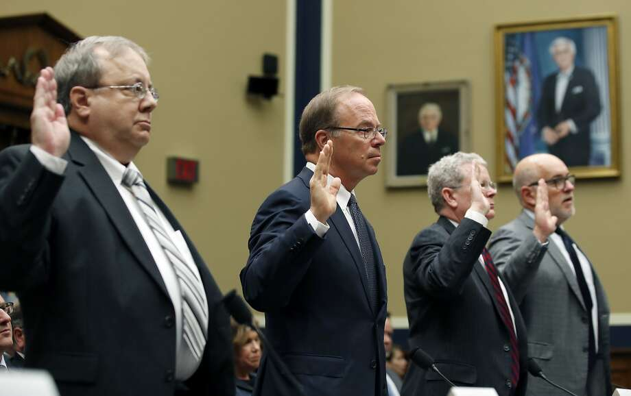 John Hammergren, CEO of San Francisco pharmaceutical distributor McKesson (center), testified with other industry executives before a House committee on Tuesday. Photo: Alex Brandon / Associated Press