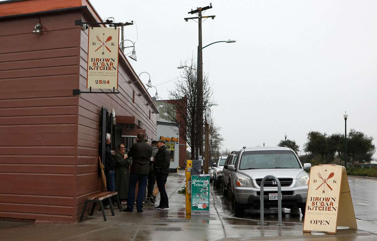 A line waits outside Brown Sugar Kitchen during breakfast in Oakland, Calif., on Sunday, February 2, 2014.