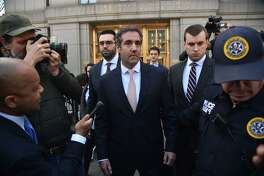 (FILES) In this file photo taken on April 26, 2018 US President Donald Trump's personal lawyer Michael Cohen(C) leaves the US Courthouse in New York on April 26, 2018. Michael Cohen, Donald Trump's personal lawyer, faced growing scrutiny May 9, 2018 following revelations that a shell company he established received millions of dollars from a Russian oligarch and corporations seeking White House access.Cohen, Trump's attorney and fixer for the past decade, is under criminal investigation in New York and his home and office were raided by the FBI last month.  / AFP PHOTO / HECTOR RETAMALHECTOR RETAMAL/AFP/Getty Images