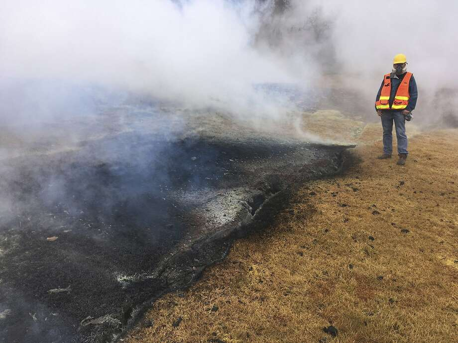 A geologist examines an inactive fissure in Leilani Estates near Pahoa on the island of Hawaii. Photo: / Associated Press
