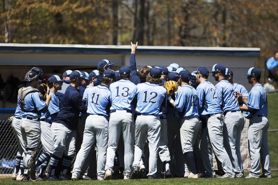 Northwood's baseball team celebrates a win over Findlay last spring. The Timberwolves will be seeking to defend their first-ever GLIAC Tournament championship this weekend in Detroit. (Daily News file photo) Photo: Daily News File Photo